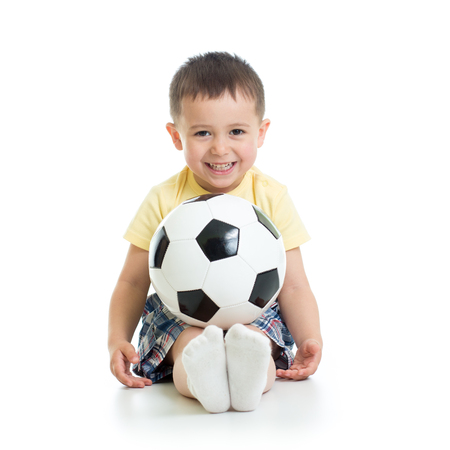 little boy with soccer ball isolated in white Banque d'images