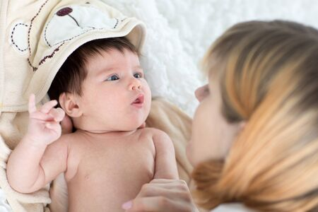 happy mother and her baby newborn looking each at other Stock Photo