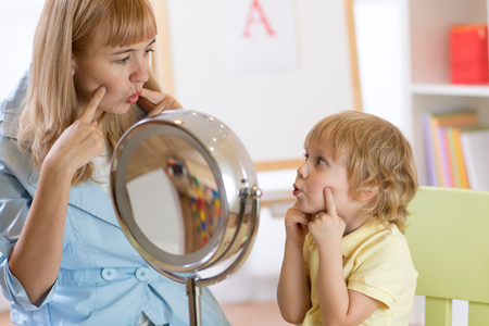Cute kid boy at speech therapist office Stock Photo