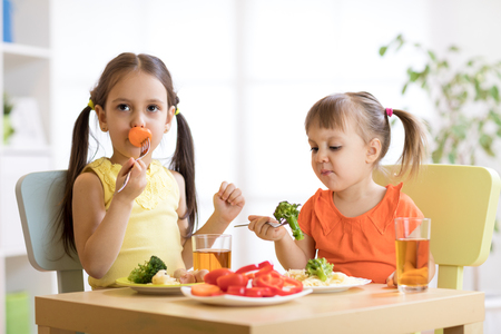 Little discontented children does not want to eat pasta with vegetables Reklamní fotografie