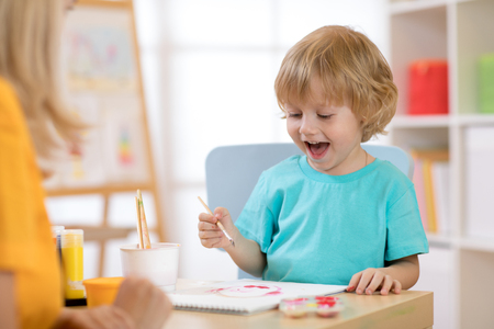 Portrait of little boy drawing something for art class Stock Photo