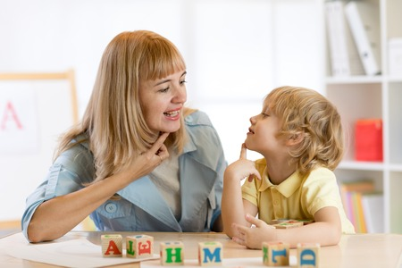 Woman teacher and little boy on private lesson