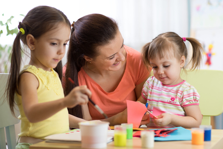 children kids girls and mother hand making at nursery or at home Zdjęcie Seryjne