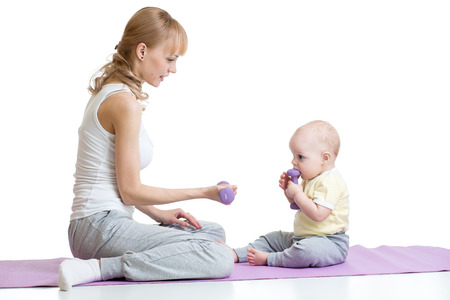 Young mom with baby doing gymnastics and fitness exercises, Isolated on white background