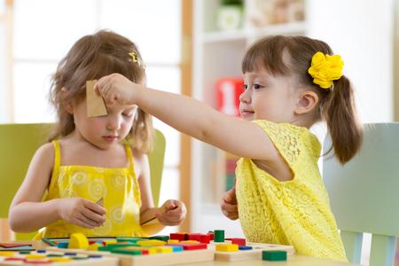 Children play educational toys in kindergarten Stock Photo