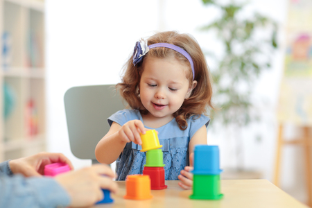 Kid playing developmental toys at home Stock Photo