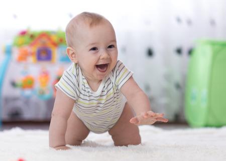 crawling funny baby boy indoors at home Foto de archivo