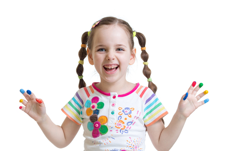Portrait of child little smiling girl with the fingers painted by a paint. Isolated on white background Stock Photo