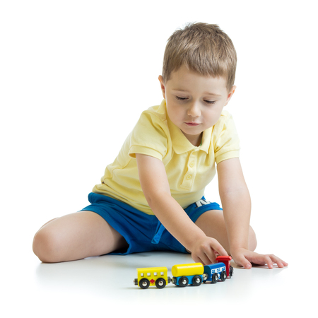 cute kid boy playing with toys at home