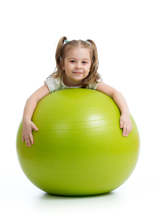 Smiling pretty kid with fitness ball. Isolated on white background. Stock Photo