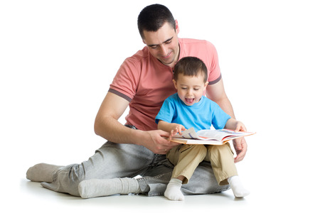 Child boy and his dad read a book