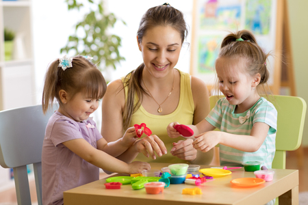 Children and mother play colorful clay toy