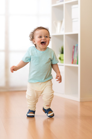 Little boy running and laughing in ther living room