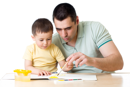 Dad and kid playing with paint colors