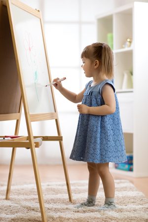 Child girl drawing at home Stock Photo