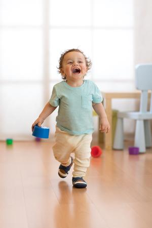 Baby toddler running indoors