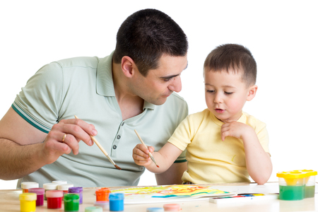 Father and kid playing with paint colors Stock Photo