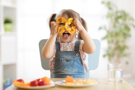 kid girl having fun with food vegetables at nursery room