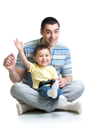kid boy and his dad playing  together Stock Photo