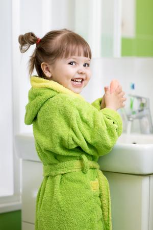 Child girl washing her hands