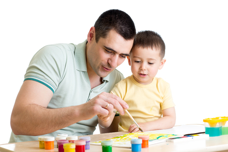 Father and child playing with paint colors Stock Photo