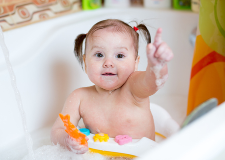 Baby playing and washing in bathroom