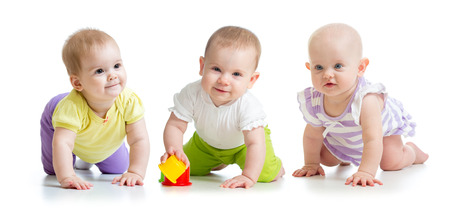 cute smiling babies girls weared clothes crawling isolated on white