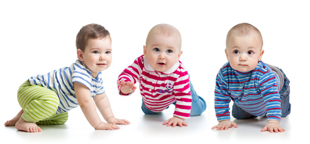Group of little babies crawling on floor. Isolated on white.