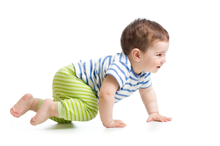 side view of baby crawling isolated on white