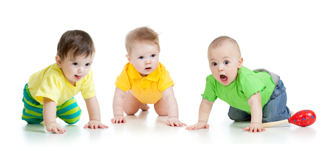 cute funny babies weared clothes crawling isolated on white