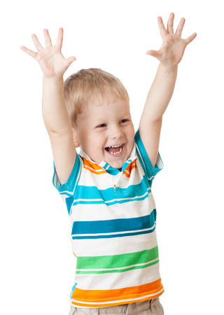 Funny kid boy shouting with his hands up isolated on white