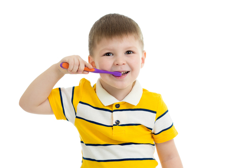 Cute little boy brushing teeth, isolated on white Stock Photo