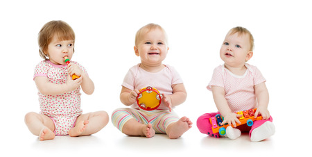 group of smart babies playing with musical toys