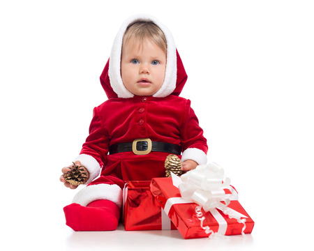 Happy baby girl wearing red Christmas Santa suit, isolated on a white background. Stock Photo