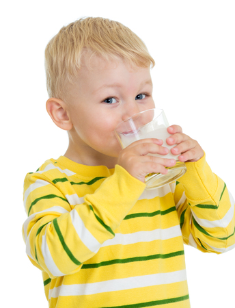 little child drinking dairy product milk or kefir isolated Stock Photo
