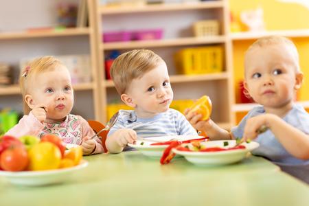 Nursery kids having meal in daycare