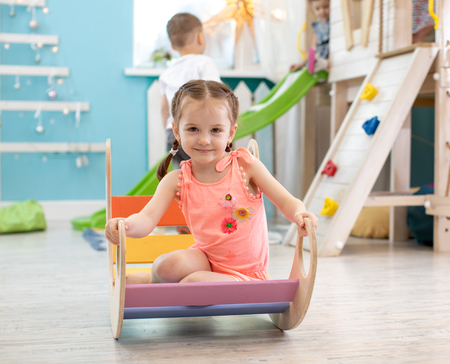 Children have fun in the playroom in the entertainment center