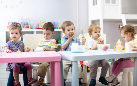 Babies have lunch in nursery