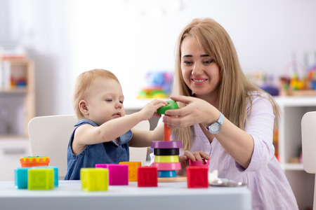 cute woman and kid play together indoor