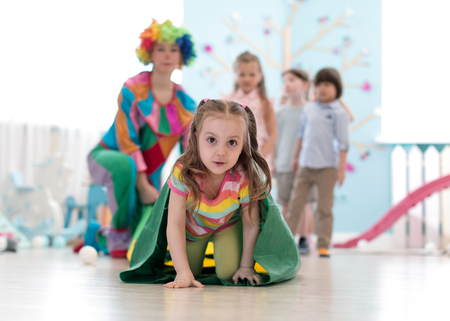 Children playing with clown on birthday party in entertainment centre Stok Fotoğraf