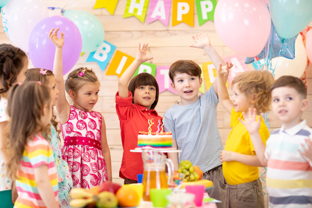 Group of 3-5 aged children celebrating birthday party merrily