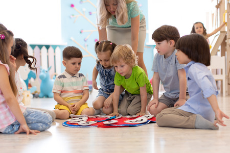 Group of kids learning time with clock toy