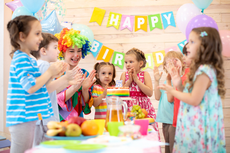 Kids are happy after they have blowed candles out on birthday party