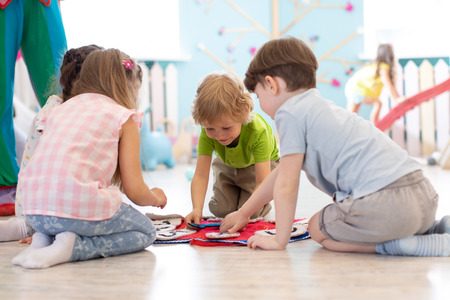Group of children learning time with clock toy