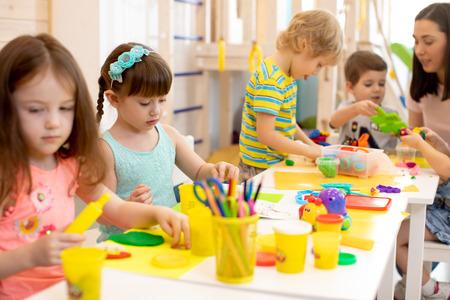 Group of preschool children engaged in handcrafts Banco de Imagens