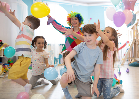 Clown at children birthday party entertaining kids Banco de Imagens