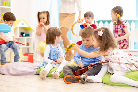 Group of kids with musical instruments in daycare Banco de Imagens