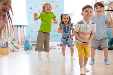 Group of happy kids playing and jumping