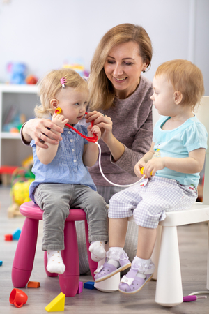 Children learning with a teacher are a doctor and patient.