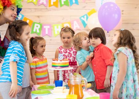 Cute little kid congratulating friend birthday boy